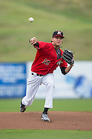 Kannapolis Intimidators starting pitcher Spencer Adams (12) in action against the Hickory Crawdads at CMC-Northeast Stadium on April 17, 2015 in Kannapolis, North Carolina.  The Crawdads defeated the Intimidators 9-5 in game one of a double-header.  (Brian Westerholt/Four Seam Images)