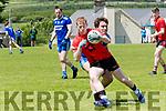 Glenbeigh/Glencar Pa K O' Sullivan tackled by Annascaul Sean O' Hara during the Football League Division 2 match at Annascaul on Sunday afternoon.