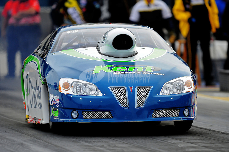 Sept. 16, 2011; Concord, NC, USA: NHRA pro stock  driver Steve Kent during qualifying for the O'Reilly Auto Parts Nationals at zMax Dragway. Mandatory Credit: Mark J. Rebilas-US PRESSWIRE