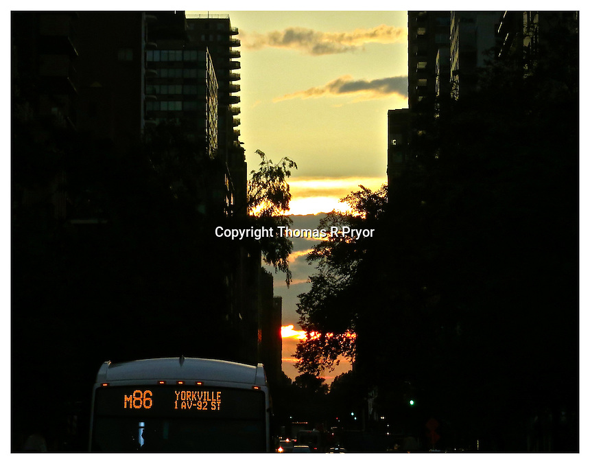 NEW YORK, NY - JUNE 24: M86 bus pictures in Yorkville during an equinox sunset in New York, New York on June 24, 2013. Photo Credit: Thomas R Pryor
