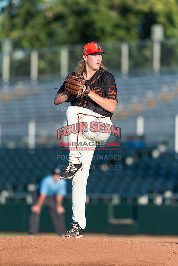 AZL Giants Orange relief pitcher Ben Strahm (13) delivers a pitch during an Arizona League game against the AZL Rangers at Scottsdale Stadium on August 4, 2018 in Scottsdale, Arizona. The AZL Giants Black defeated the AZL Rangers by a score of 3-2 in the first game of a doubleheader. (Zachary Lucy/Four Seam Images)