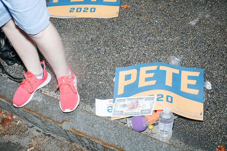 Signs in support of Democratic presidential candidate and South Bend, Ind., mayor Pete Buttigieg are seen on the ground during the Labor Day Parade in Milford, New Hampshire, on Mon., September 2, 2019. Candidates Bernie Sanders and Vermin Supreme were the only candidates who marched in the parade this year.