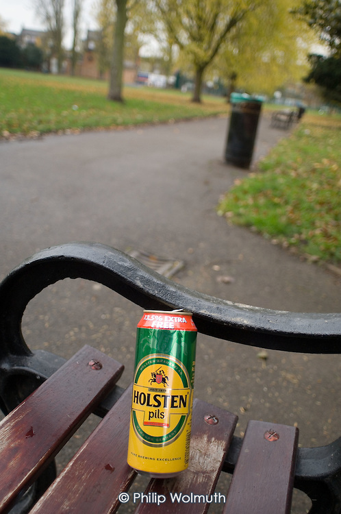 Empty beer can on a park bench in Kilburn, London.