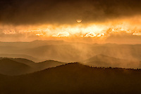 Misty autumn sunrise and Blue Ridge Mountains from Blue Ridge Parkway from Pounding Mill Overlook