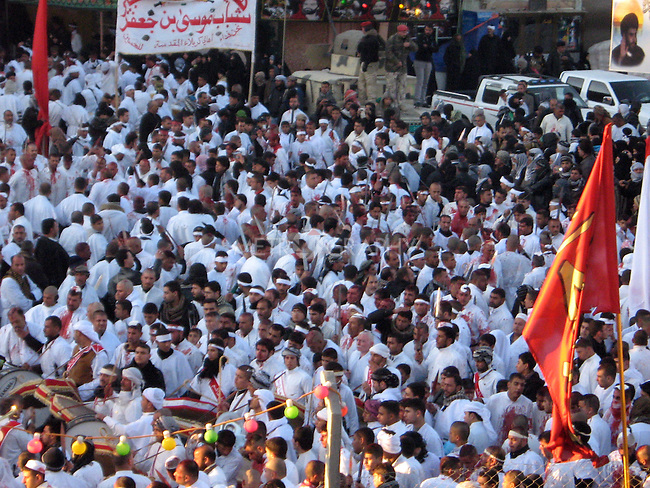 KARBALA, IRAQ: Crowds of devout Shia gather on Ashura, the day of mourning for the death of Imam Hussein...Photo by Sami Al-Hilali/Metrography