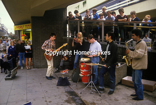 Stockport Lancashire teens busking in shopping mall center  1980s England.