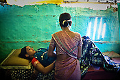 A nurse speaks with a pregnant woman during pre natal check ups at the delivery hut in Barwa village of East Champaran district of Bihar, India. Initiated to provide better pre-natal care to the pregnant women, Duncan Hospital with collaboration with Geneva Global has initiated a special campaign - delivery hut. Villagers here are told about various health issues, women go through free pre-natal check ups etc. Since 2008 the Foundation and Geneva Global have been investing in the training of medical staff to improve the lives of people living in 600+ villages in the region. The NGOs are delivering cost effective interventions to address treatment, care and prevention of diseases, disability and preventable deaths amongst infants, adolescent girls and women of child-bearing age. There is statistical and anecdotal evidence that there have been vast improvements and a total of 40-50% increased immunization for all children under 6 has meant that communities can be serviced and educated long term. Photograph: Sanjit Das/Panos for Legatum Foundation