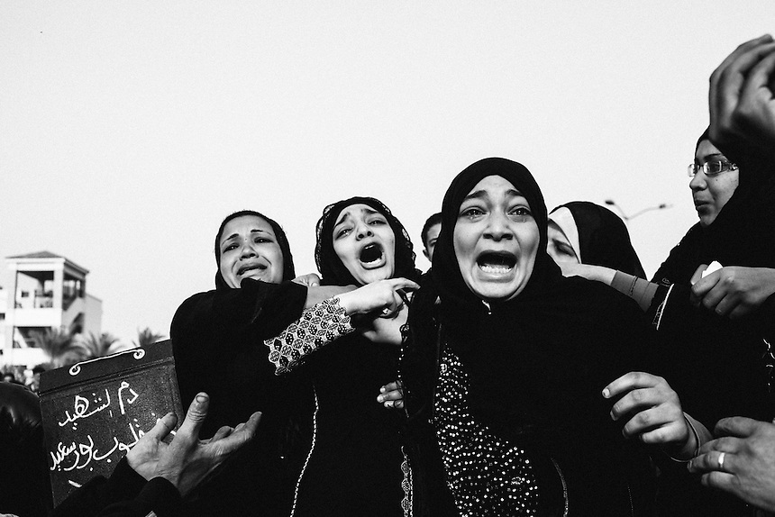 Family members of Ahmed Abdul Khalim, 24, a demonstrator killed in violent clashes with Egyptian security forces in previous days, cry as the coffin of Khalim is carried by on March 8, 2013, in Port Said, Egypt. Violent protests rocked the city of Port Said, the site of the Mediterranean entry to the Suez Canal, ahead of a March 9 verdict in a crucial court case presiding over the Port Said football stadium massacre in February 2012. PHOTO: ED GILES.