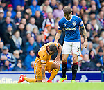 Rob Kiernan helps Scott McDonald to his feet