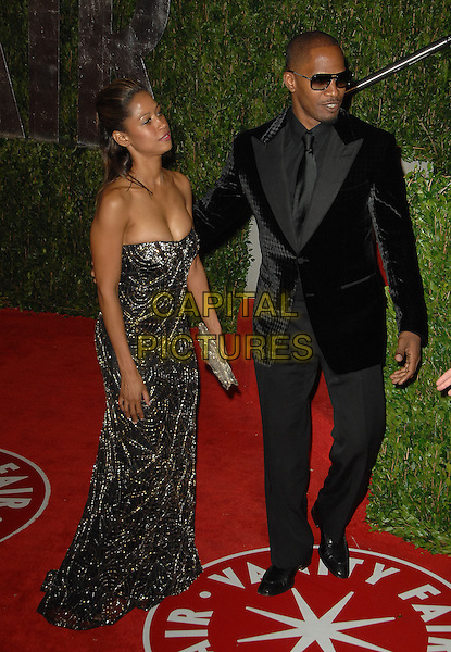 STACEY DASH & JAIME FOXX.The 2010 Vanity Fair Oscar Party held at The Sunset Tower Hotel in West Hollywood, California, USA..March 7th, 2010.oscars full length black suit strapless beds beaded maxi dress profile gold silver jamie couple sunglasses shades.CAP/RKE/DVS.©DVS/RockinExposures/Capital Pictures.