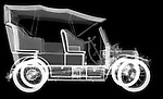 X-ray image of an antique car (white on black) by Jim Wehtje, specialist in x-ray art and design images.