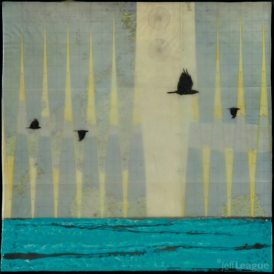 Crows flying over sea transferred over world map with encaustic painting.