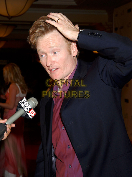 CONAN O'BRIEN.Tiger Jam VIII benefiting the Tiger Woods Foundation held at Mandalay Bay Resort & Casino, Las Vegas, Nevada.May 21st, 2005.Photo Credit: Laura Farr/AdMedia.half length touching head microphone interview.www.capitalpictures.com.sales@capitalpictures.com.© Capital Pictures.