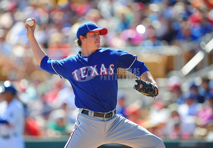 Mar. 16, 2012; Phoenix, AZ, USA; Texas Rangers pitcher Tanner Scheppers throws in the fourth inning against the  Los Angeles Dodgers at The Ballpark at Camelback Ranch. Mandatory Credit: Mark J. Rebilas-