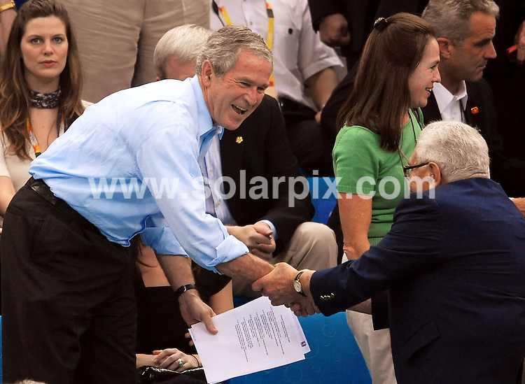 **ALL ROUND PICTURES FROM SOLARPIX.COM**.**SYNDICATION RIGHTS FOR UK, SPAIN, PORTUGAL, AUSTRALIA, S.AFRICA & DUBAI (U.A.E) ONLY**.The 2008 Olympic Games Day 4 at the Swimming and National Aquatic Centre in Beijing, China. .This  pic:George Bush and Henry Kissinger.JOB REF:7000-PHZ/Insidefoto   DATE:10_08_08 .**MUST CREDIT SOLARPIX.COM OR DOUBLE FEE WILL BE CHARGED* *UNDER NO CIRCUMSTANCES IS THIS IMAGE TO BE REPRODUCED FOR ANY ONLINE EDITION WITHOUT PRIOR PERMISSION*