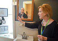 Lisa Decker (right) of LD Interiors speaks with Jeff Brown about the bathroom she will design at the Bucks County Designer House Empty House Party Sunday, February 26, 2017 in Buckingham, Pennsylvania. (Photo by William Thomas Cain)