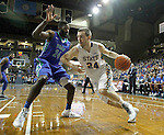 SIOUX FALLS, SD - NOVEMBER 30:  Zach Horstman #24 from South Dakota State University drives against Marcus Blake #24 from Florida Gulf Coast in the first half of their game Sunday afternoon at the Sanford Pentagon in Sioux Falls. (Photo by Dave Eggen/inertia)