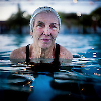 A portrait of 73 year old Margo Bouer who is a member of the Aquadettes at Laguna Woods, California. Margo suffers from severe MS, but says her nausea and shaking almost disappear when she is in the swimming pool. She has been with the Aquadettes for 16 years. The Aquadettes are a group of women ageing from their early 60s upwards who meet to practice synchronised swimming. Every year, they practice together, they make costumes together, they swim together, and at the end, they perform together.
