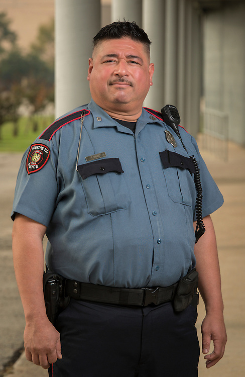 Houston ISD officer Robert Valdez poses for a photograph, December 5, 2013. While off-duty, Valdez assisted the Houston PD in apprehending a pair of bank robbers.