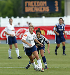 19 June 2004: Kristine Lilly (13) and Julie Foudy (11). The Washington Freedom tied the Boston Breakers 3-3 at the National Sports Center in Blaine, MN in Womens United Soccer Association soccer game featuring guest players from other teams.