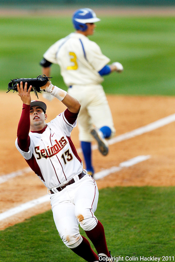 TALLAHASSEE, FL 2/26/11-FSU-HOFSTRA BASE11 CH-Florida State's Eric Arce snags the pop fly of Hofstra's Joe Perez, right, for the second out in the top of the eighth inning Saturday at Dick Howser Stadium in Tallahassee. The Seminoles beat the Pride 16-3...COLIN HACKLEY PHOTO