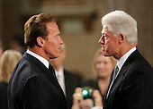 Boston, MA - August 29, 2009 -- California Governor Arnold Schwarzenegger, left, speaks with former U.S. President Bill Clinton, right, during funeral services for U.S. Senator Edward Kennedy at the Basilica of Our Lady of  Perpetual Help in Boston, Massachusetts August 29, 2009.  Senator Kennedy died late Tuesday after a battle with cancer.  .Credit: Brian Snyder- Pool via CNP