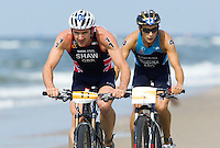 13 JUL 2013 - DEN HAAG, NED - Asa Shaw (GBR) (left) of Great Britain leads Gonzalo Raul Tellechea (ARG) (right) of Argentina during the bike at the  2013 ITU Elite Men's Cross Triathlon World Championships in Kijkduin, Den Haag (The Hague), the Netherlands (PHOTO COPYRIGHT © 2013 NIGEL FARROW, ALL RIGHTS RESERVED)