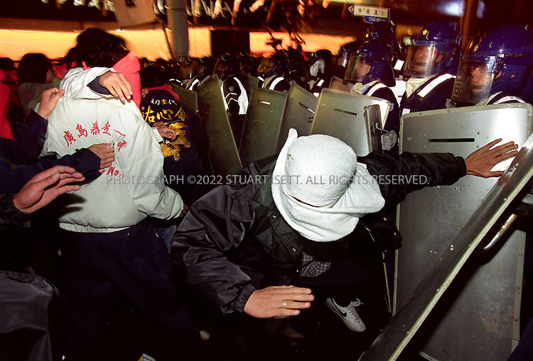 11/18/1999--Hiroshima, Japan..Bosozoku gang members rioting on the streets of Hiroshima. Such gangs have been common in Japan for many years and are considered stepping stones to join yakuza gangs and 'uyoku' or rightwing nationalsist groups....All photographs ©2003 Stuart Isett.All rights reserved.This image may not be reproduced without expressed written permission from Stuart Isett.
