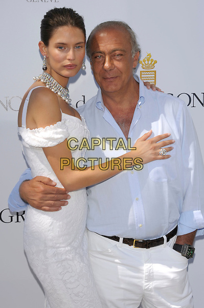 BIANCA BALTI & FAWAZ GRUOSI.Model Bianca Balti and President, owner and founder of de Grisogono Fawaz Gruosi attends the de Grisogono photocall during the 64th Annual Cannes Film Festival at the Martinez Hotel, Cannes, France..May 16th, 2011 .half length dress blue shirt arm around waist white off the shoulder  side necklace silver earrings pearls diamonds .CAP/PL.©Phil Loftus/Capital Pictures.