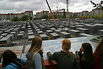 School pupils study the plans for the soon-to-be-completed memorial to the Jewish victims of the Nazi era which is being built on former no-man's land on the site of the former Cold War barrier. The Wall was opened 15 years ago on 9th November 1989.