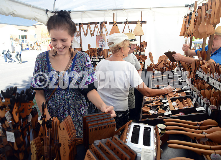 NEW HOPE, PA - SEPTEMBER 27:  Anne Marie Sicilia, of Newtown, Pennsylvania (L) and Irene Treidel along with her husband Kenn Treidel of Seaside Park, New Jersey view some wood work during the New Hope Arts Festival at New Hope-Solebury High School September 27, 2014 in New Hope, Pennsylvania. (Photo by William Thomas Cain/Cain Images)