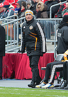 20 April 2013: Houston Dynamo head coach Dominic Kinnear watches the action during an MLS game between the Houston Dynamo and Toronto FC at BMO Field in Toronto, Ontario Canada..The game ended in a 1-1 draw...
