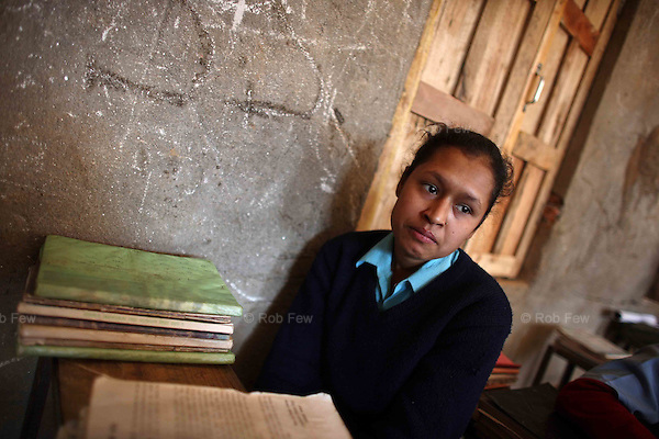 At Maina's former school, her desk is empty. For her mother, schoolgirls are a distressing reminder of what she has lost. Whenever one of Maina's age walks by, she says she wants to cry.
