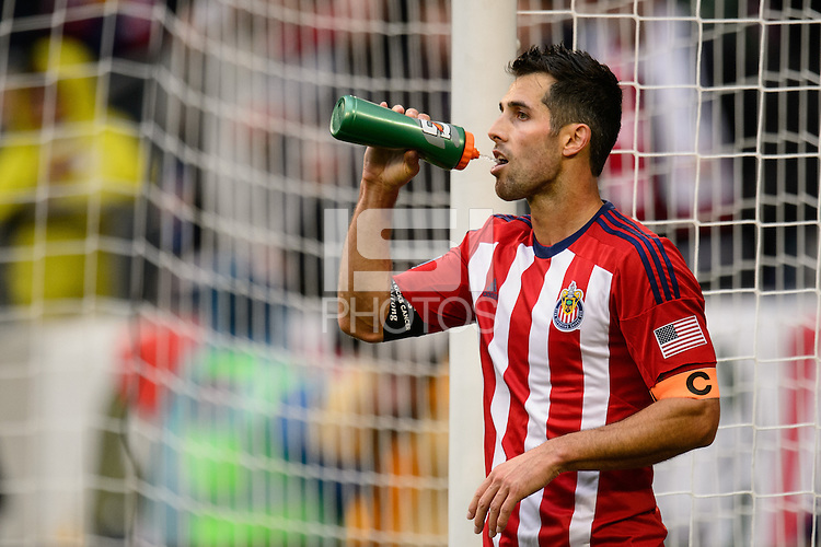 Carlos Bocanegra (3) of Chivas USA takes a drink. The New York Red Bulls and Chivas USA played to a 1-1 tie during a Major League Soccer (MLS) match at Red Bull Arena in Harrison, NJ, on March 30, 2014.