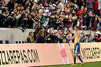 David Beckham (23) of the Los Angeles Galaxy hands his jersey to a fan after the match. The New York Red Bulls defeated the Los Angeles Galaxy 2-0 during a Major League Soccer (MLS) match at Red Bull Arena in Harrison, NJ, on October 4, 2011.
