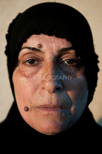 KIRKUK, IRAQ: Halima Majid lost her hearing after an explosion...Kirkuk, the oil-rich city in northern Iraq, is home to Kurds, Arabs, Turkomen, Christians, Kakayi, and numerous other ethnicities. Since 2003, thousands of its residents have been killed or injured in terrorist attacks...As the US military leaves Iraq, the future of this violent and ethnically diverse city remains unsure...Photo by Pazhar Mohammad/Metrography