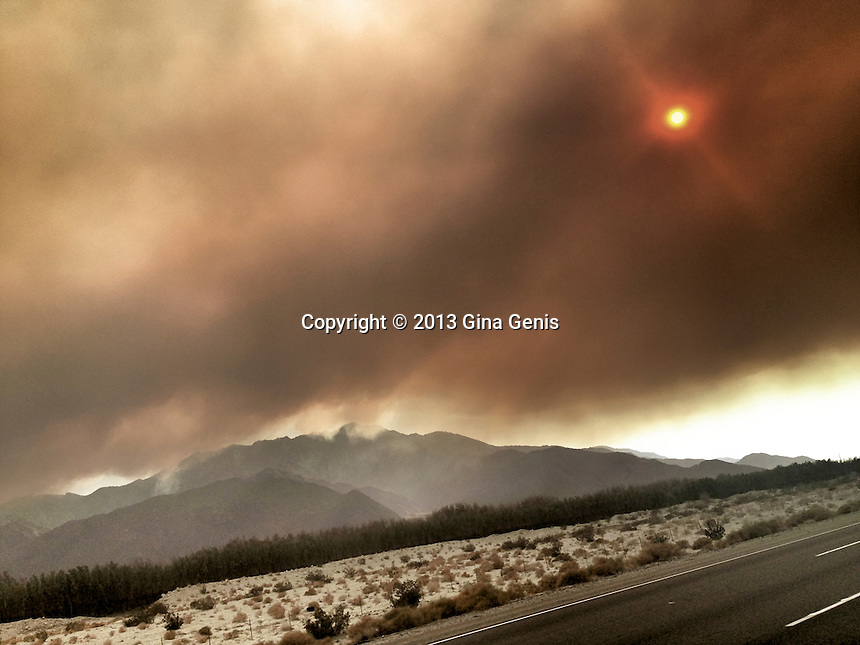 Flaming sun showing through the fire clouds from the Mountain Center fire as seen from the 10 Freeway on July 15, 2013.
