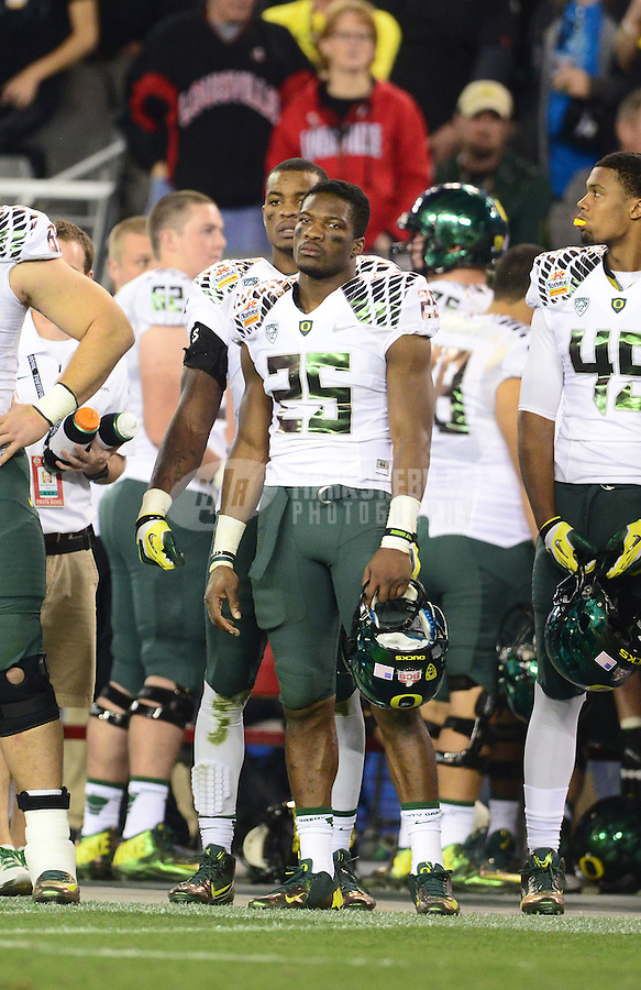 Jan. 3, 2013; Glendale, AZ, USA: Oregon Ducks linebacker Boseko Lokombo (25) against the Kansas State Wildcats during the 2013 Fiesta Bowl at University of Phoenix Stadium. Oregon defeated Kansas State 35-17. Mandatory Credit: Mark J. Rebilas-