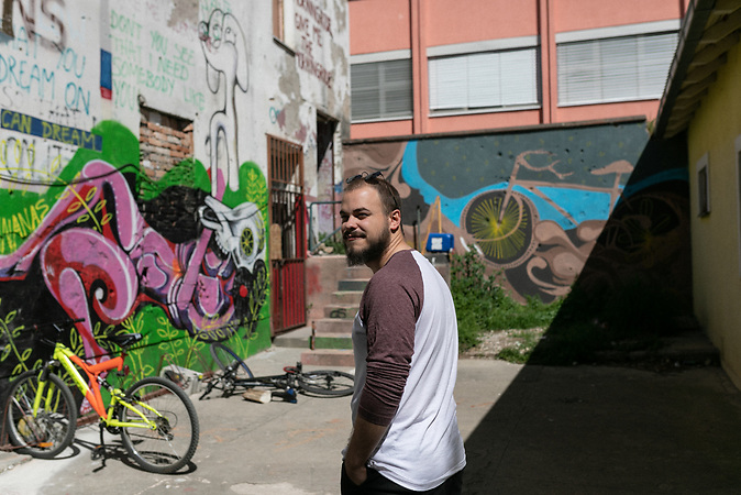 Art student Luka Tomic in front of his graffiti in Abrasevic center.
