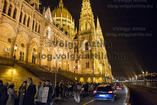 Members of opposition group Democratic Coalition form a human chain around Parliament to protest election law changes in Budapest, Hungary on November 19, 2012. ATTILA VOLGYI