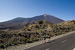 Couple hiking with background of  Mount Teide, Parque Nacional de Las Cañadas del Teide.