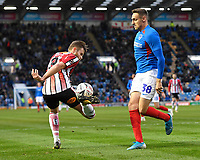 Andy White of Altrincham  left  controls the ball beside Brandon Haunstrup of Portsmouth during Portsmouth vs Altrincham, Emirates FA Cup Football at Fratton Park on 30th November 2019