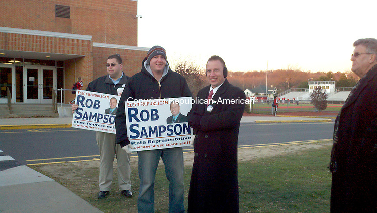 State Sen. Rob Sampson, R-Wolcott, third from left, campaigns outside Wolcott High School Tuesday afternoon. He is running for a second term in the 80th House District, which includes Wolcott and part of Southington.  Drew Larson Republican-American
