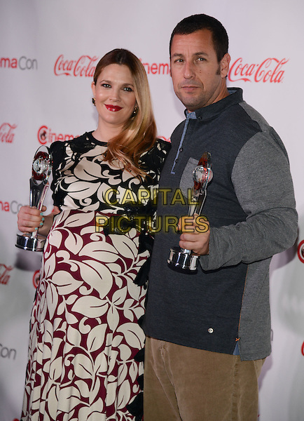 LAS VEGAS, NV - March 27: Female Star of the Year Award winner Drew Barrymore and Male Star of the Year Award winner Adam Sandler at the CinemaCon Big Screen Achievement Awards on March 27, 2014 in Las Vegas, Nevada.<br /> CAP/MPI/RTNKAB<br /> &copy;RTNKAB/MPI/Capital Pictures
