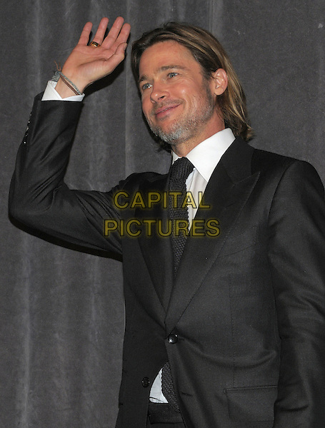 "Brad Pitt .""Moneyball"" Premiere - 2011 Toronto International Film Festival held at Roy Thomson Hall, Toronto, Ontario, Canada .9th September 2011..half length beard facial hair knitted tie black white shirt hand waving .CAP/ADM/BPC.©Brent Perniac/AdMedia/Capital Pictures."