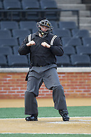 Home plate umpire Jamie Roebuck calls a batter out on strikes during the NCAA baseball game between the Marshall Thundering Herd and the Wake Forest Demon Deacons at Wake Forest Baseball Park on February 17, 2014 in Winston-Salem, North Carolina.  The Demon Deacons defeated the Thundering Herd 4-3.  (Brian Westerholt/Four Seam Images)