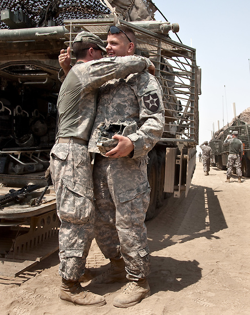 SOUTHERN IRAQ 18 AUGUST 2010:  Soldiers of the 4/2 Strykers Brigade smiling and exchanging hugs as their  convoy takes a breather en-route to the Kuwait border where they will be packing up and heading back to the USA.  Iraq is preparing after US President Barack Obama has confirmed the end of all combat operations in the country by 31 August..Some 50,000 of 65,000 US troops currently in Iraq are set to remain until the end of 2011 to advise Iraqi forces and protect US interests.The remaining 50,000 troops will stay in the country in order to train Iraqi security forces, conduct counterterrorism operations and provide civilians with ongoing security, said Mr Obama..An agreement negotiated with the Iraqis in 2008 states that these troops must be gone from the country by the end of next year. pic Graham Crouch/The Guardian