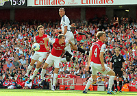 Pictured: Steven Caulker of Swansea (TOP) heads the ball over L-R Aaron Ramsey, Laurent Koscielny and Bacary Sagna of Arsenal. Saturday 10 September 2011<br /> Re: Premiership Arsenal v Swansea City FC at the Emirates Stadium, London.
