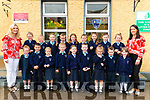 Gerardine Shanahan Principal and class teacher Mary V O'Leary with her new junior infants front l-r Aisling Fenton, Evan Dela Torre, Mairead O'Leary, Evan Barrett, Amelia Fleming, Kai O'Leary, Cara Mc Ilroy, Max O'Leary and Nicole O'Connor back l-r Jessica Lynch, Jerry Shields, Holly Anderson, Kealan Gleeson, Sinead Hurley, Micheal Lawlor, Skylar Mc Sweeney, Luke O'Leary O Sullivan and Ava Knee on their first day of school in Gneeveguilla NS last Thursday.