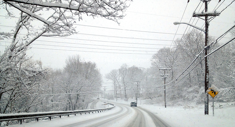 Wolcott, CT. 08 March 2013-030813SV05-It was slow traveling as snow blankets the area  on Wolcott Road during the recent snowstorm in Wolcott Friday..Steven Valenti Republican-American